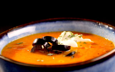 Sweet paprika soup with black olives