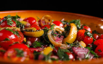 Tomato salad with slices of grilled lemon
