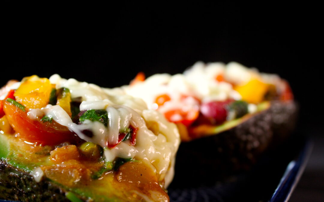 Baked avocado with kidney beans, paprika and tomato