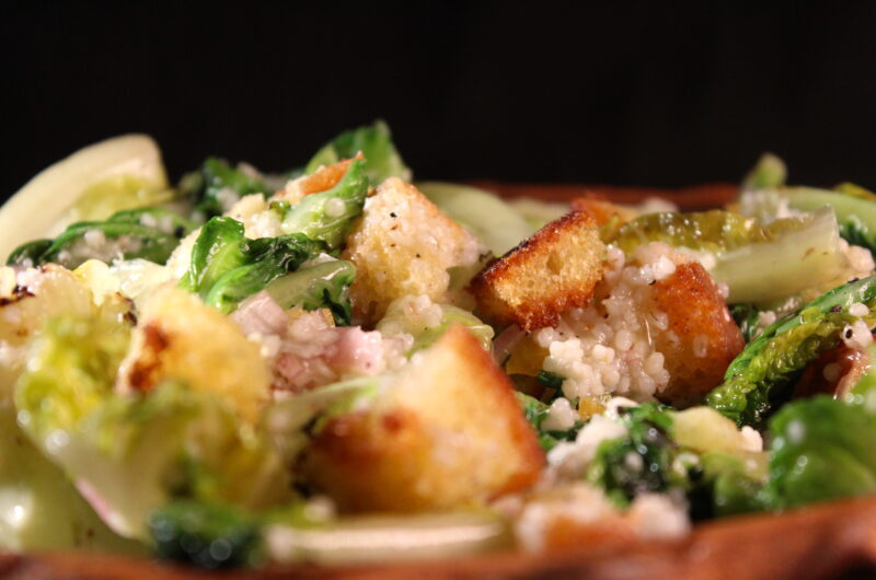 Fried romaine lettuce with lemon, ouzo, barley and croutons
