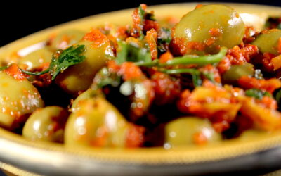 Spicy green olives in grilled peppers