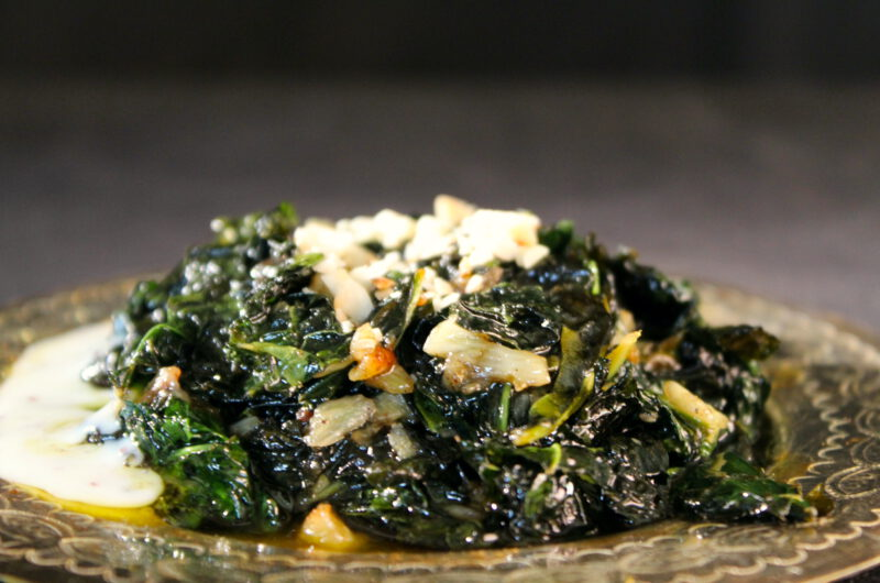 Fried cavolo nero in garlic-lemon butter and toasted almonds