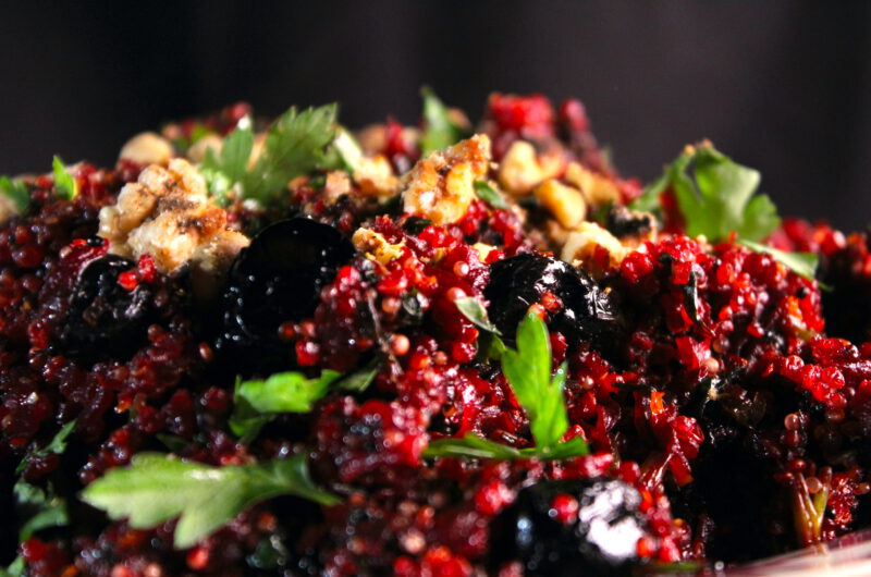 Baked quinoa with beets, black olives, orange and walnut