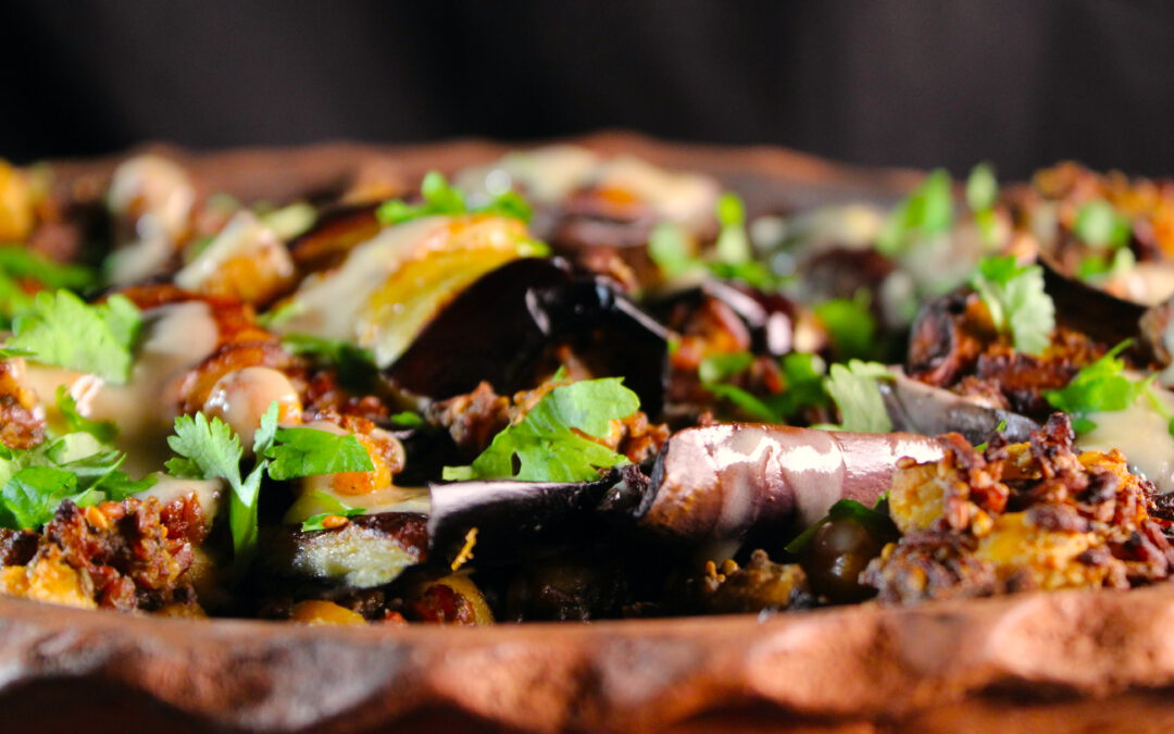 Eggplant rice rolls with lemon tahina sauce