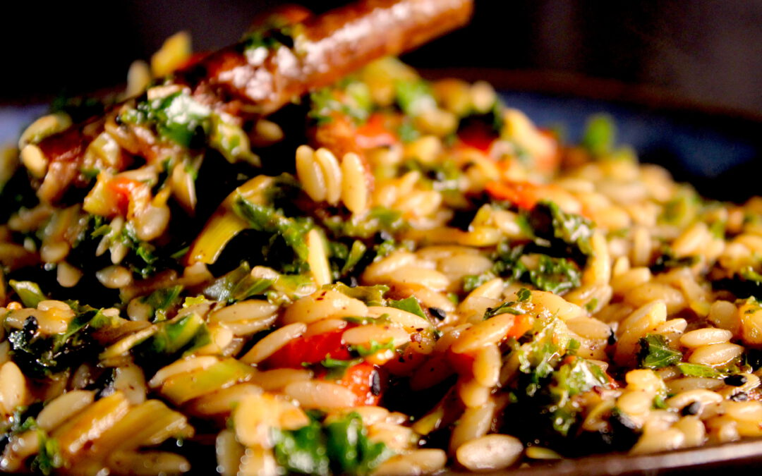 Exciting and unctuous orzo with kale, tomato and more…